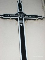 cross for pest victims